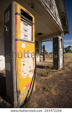 Photo of two old defunct gas pumps located near a ghost town in Oregon. - stock photo