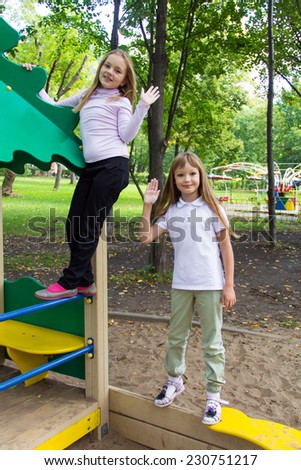 Photo of two playing girls in summer