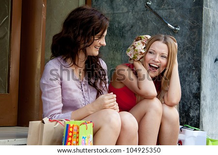 Photo of two young and beautiful women who go shopping - stock photo