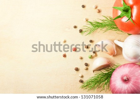 Photo of vegetables fresh tomato with onion, garlic and spices on cutting board - stock photo