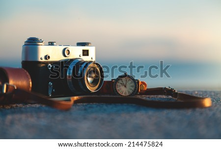 Photo of vintage camera at sunset in park - stock photo