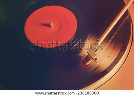 photo of Vintage vinyl record with red label, retro film filtered, instagram style  - stock photo