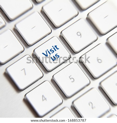 Photo of visit us button on the white keyboard.