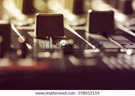 Photo of volume sliders on a sound mixer controller.Vintage look. - stock photo