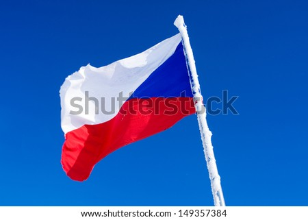 Photo of waving Czech Flag on blue sky  - stock photo