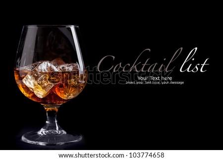 photo of whiskey cognac on black background - stock photo