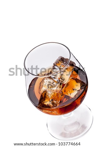 photo of whiskey cognac with ice cubes on white background - stock photo