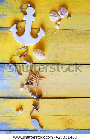 Photo of white anchor on wooden background - stock photo