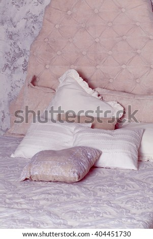 photo of white pillows on classic bed in bedroom