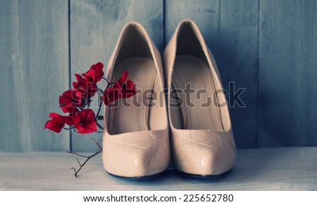 Photo of white shoes and flowers - stock photo