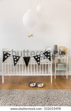 Photo of white wooden crib in kid room - stock photo