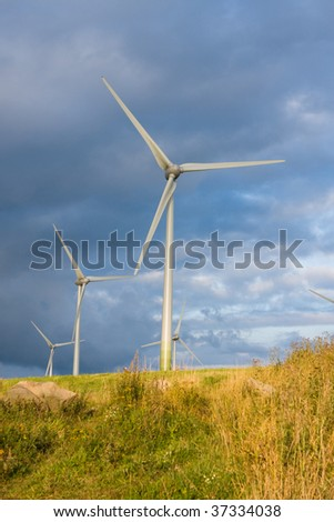 Photo of Wind power installation in cloudy day - stock photo