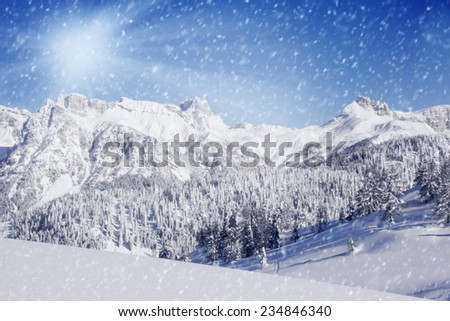 Photo of winter landscape with trees and mountains covered by snow
