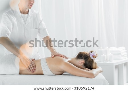 Photo of woman reaching body mind harmony during therapy massage - stock photo