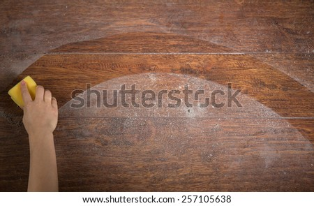 Photo of woman's hand cleaning the wooden floor - stock photo