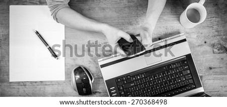 Photo of woman texting message at the home office, top view - stock photo