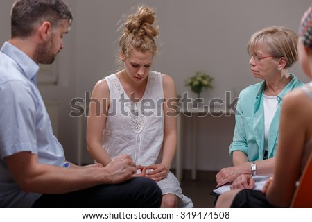 Photo of woman with eating disorder and support group - stock photo
