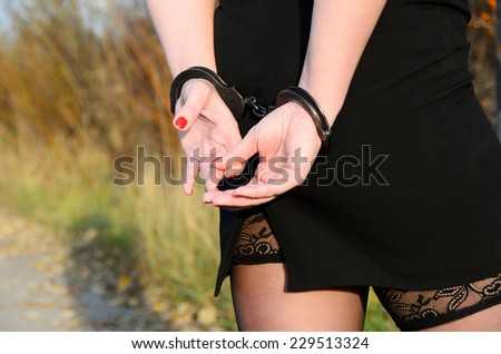 Photo of women handcuffed criminal police - stock photo