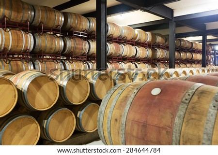 photo of  wooden barrels in  winery factory  - stock photo