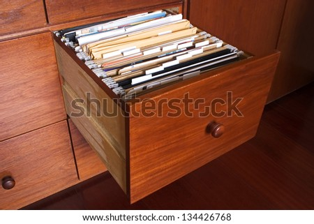 Photo of Wooden file cabinet - stock photo