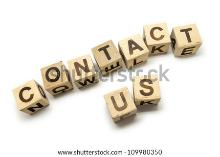 Photo of wooden letter blocks with the note Contact Us on the white background - stock photo