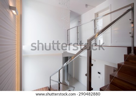 Photo of wooden staircase in one-storey exclusive villa - stock photo