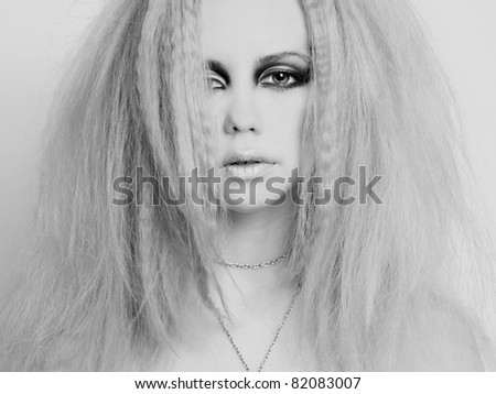 Photo of young beautiful woman with bright make-up - stock photo
