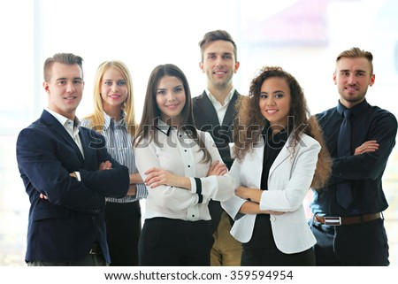 Photo of young business people in a conference room - stock photo