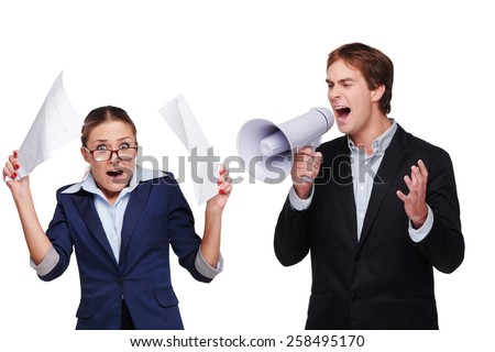 Photo of young business woman and man. Boss screaming with megaphone at his scared assistant. Isolated on white background - stock photo