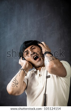 photo of young dj with headphones singing his song