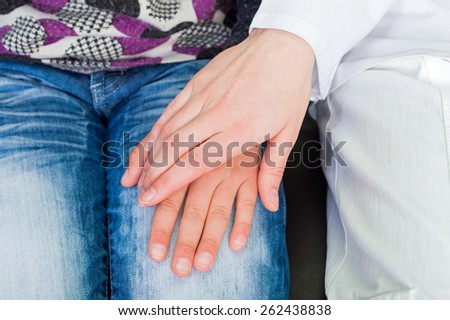 Photo of young doctor hand on the child hand - stock photo