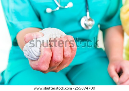 Photo of young doctor squeezing the stress ball - stock photo