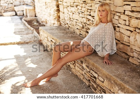Photo of young pretty woman blond - stock photo