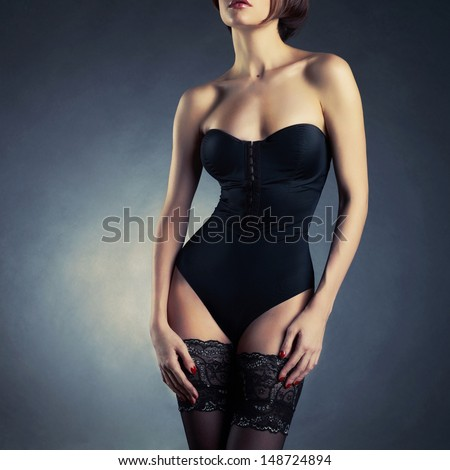 Photo of young slim woman in stylish lingerie - stock photo