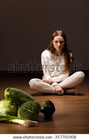 Photo of young starving female with mental problem - stock photo