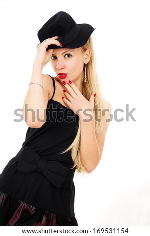 Photo of young woman in a black dress with the hat. Girl posing isolated on white background
