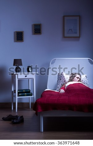 Photo of young woman sleeping after work in new apartment