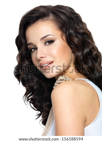 Photo of  young  woman with beauty long curly hair. Fashion model - side view portrait. - stock photo