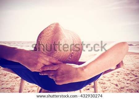 photo on beach and chair and woman in hat  - stock photo