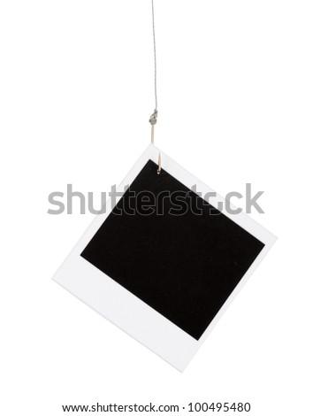 Photo on fish hook isolated on white - stock photo