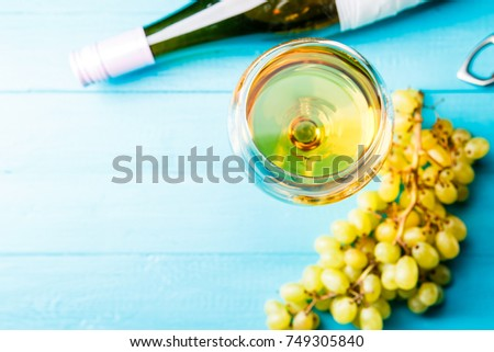 Photo on top of glass with juice, grape, bottle