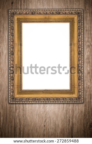 Photo or painting frame on wooden background.