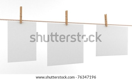 Photo paper attach to rope with clothes pins on white background