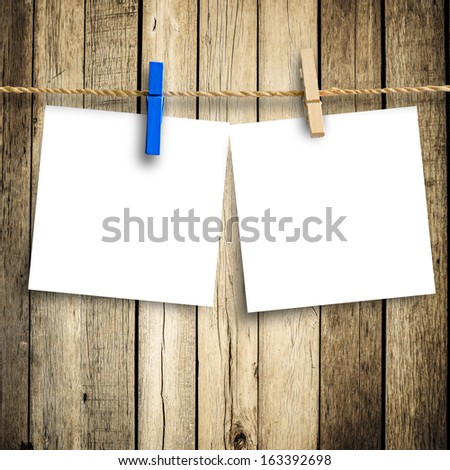 photo paper attach to rope with clothes pins on wooden background  with clipping path 2 - stock photo
