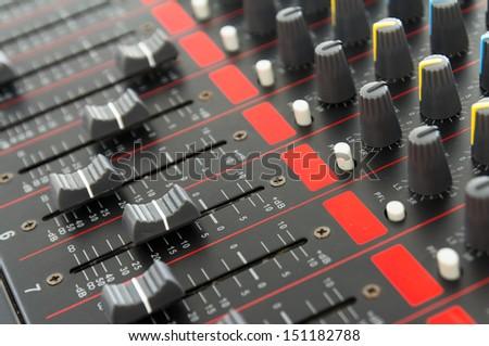 Photo  part of control an audio sound mixer - stock photo