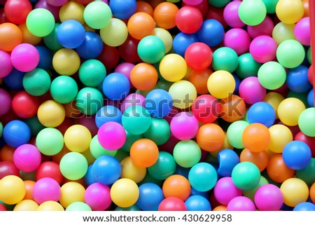 Photo plenty of multi colored bright plastic balls, children playground, pool for children, background, horizontal picture, family weekend concept, happy birthday and merry party