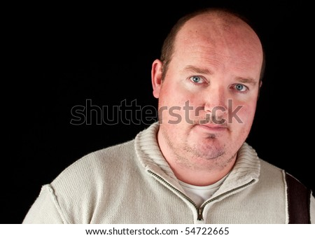 photo portrait of a handsome fit irish male man on black background. wearing casual irish knitted fashion.
