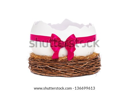Photo prop egg shell in nest decorated with bow