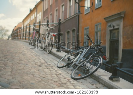 Photo retro bicycle in the old town of Stockholm. Effect retro film - stock photo