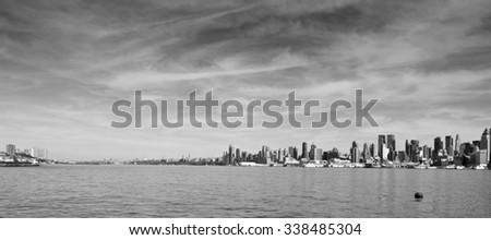 photo scenic new york city skyline over hudson river - stock photo